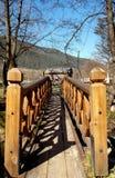 Causeway. A bridge over the river towards the house Stock Photos