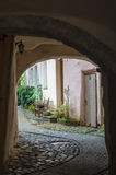 Causeway leading in courtyard through passage Stock Images
