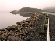 Causeway in the Morning. Causeway to Eastport, Newfoundland in the Morning with fog Stock Photos