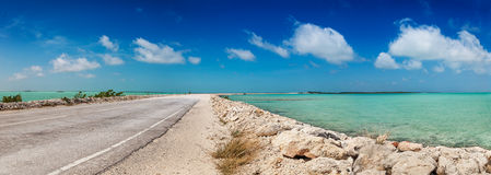 Causeway between North and Middle Caicos. Part dirt, part pavement - the causeway between North and Middle Caicos curves through the shallow turquoise waters of Royalty Free Stock Images