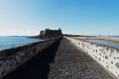 Causeway to Islet of the English. One of two causeways leading to Islet of the English, Arrecife. Situated on this islet is the Castle of San Gabriel royalty free stock photography