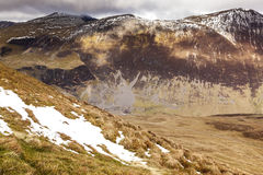 Causey Pike Walk. Scar Crags on the descent from Causey Pike. Even though it was April there was still a sprinking of snow on the top of Scar Crags. Scar Crags stock image