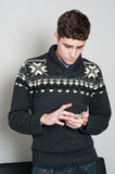 Causual teenage boy looking at his cell phone Stock Photography