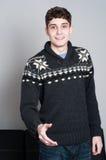 Causual teenage boy ready to shake hands Royalty Free Stock Photos