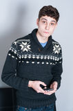 Causual teenage boy texing Royalty Free Stock Photo