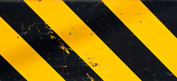Caution. Or warning in black and yellow stripes Stock Photo