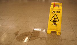 Caution. Wet floor sign near Royalty Free Stock Photos