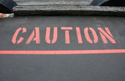 Caution. Bold Red Caution warning of danger ahead royalty free stock image