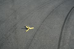 Caution. A banana peel waiting for the next pedestrian stock photo