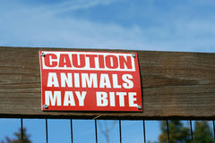 Caution animals may bite sign Stock Photo