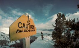 Caution Avalanche Danger Sign on Snow Mountain Royalty Free Stock Images