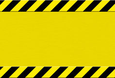 Caution background. Yellow and black caution background Stock Photos