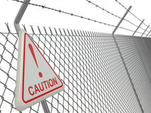 Caution. barbed wire fence with sign. Royalty Free Stock Image