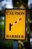 Caution barrier sign. At the exit to a car park adjacent to a footpath intended for the general public Royalty Free Stock Images