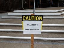Caution bees on handrail sign on steps. Or stairs royalty free stock photography