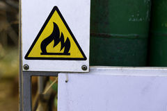 Caution Board - flammable. On the magazine Royalty Free Stock Photography