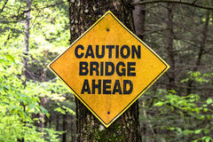 Caution bridge sign. Caution bridge ahead sign on tree Royalty Free Stock Photos