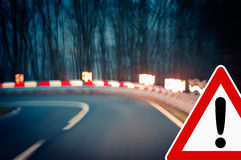 Caution - Curvy Road at Night Stock Photo