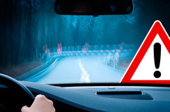 Caution - curvy road at night Royalty Free Stock Photo
