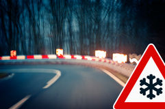 Caution - Curvy Road at Night - Risk of Black Ice Stock Photos