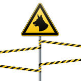 Caution - danger Be aware of dogs The area is guarded by dogs. Warning sign safety. The sign on the pole and warning bands. White Stock Photography