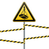 Caution - danger May fall from the height of the load. Safety sign. The triangular sign on a metal pole with warning bands. Light. Caution - danger May fall from Royalty Free Stock Images
