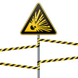 Caution - danger Warning sign safety. Explosive substances. A yellow triangle with a black image. The sign on the pole and protect. Caution - danger Warning sign Royalty Free Stock Photography
