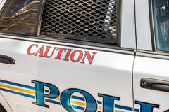 Caution decal on side of police car Stock Photography
