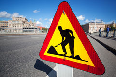 Caution digging sign. On city background royalty free stock photography