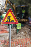 Caution Digging Sign Workers Royalty Free Stock Photography