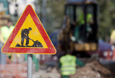 Caution Digging Sign Workers Royalty Free Stock Photo