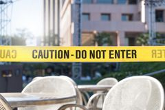 Caution, do not enter line tape and ribbon in city. Caution, do not enter line tape and ribbon in city, outdoor terrace, restaurant or building. Construction or royalty free stock photo