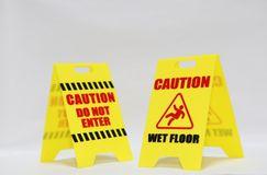 Caution do not enter and wet floor signage. Isolated Stock Photos