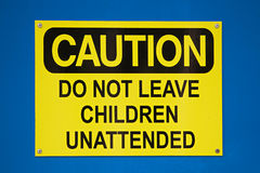 Caution do not leave children sign on a blue background Stock Photo