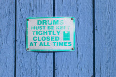 Caution .This drums must be kept closed. Font poster , safety an Stock Image