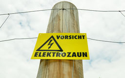 Caution electric fencing Stock Image