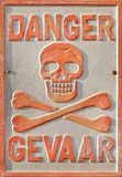 Caution Electricity. A vintage warning sign on a generator house in South Africa Royalty Free Stock Photos