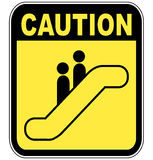 Caution escalator sign Stock Photos