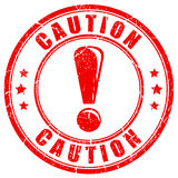 Caution exclamation rubber stamp Royalty Free Stock Photos
