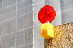 A Caution flashing lamp at hazard zone.  Stock Photo