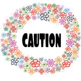 CAUTION in floral frame. Stock Photography