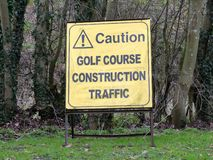 Caution golf course construction traffic sign. A sign on Green Street in the village of Chorleywood, Hertfordshire, UK stock photography