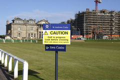 Caution golf in  progress. Caution sign on the old course of Saint Andrews golfcourse Stock Photography