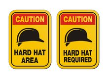 Caution hard hat required signs - yellow signs Stock Photo