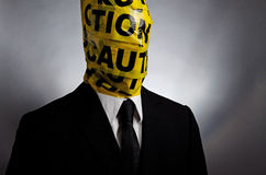 Caution Head. Image of a man with caution tape wrapped around his head Royalty Free Stock Image
