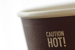 Caution hot. Coffee cup with hot caution sign Royalty Free Stock Photography
