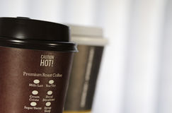 Caution hot. Sign on coffee cup Royalty Free Stock Photography