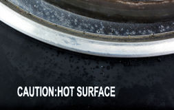 Caution hot surface print on dirty burner Stock Photography