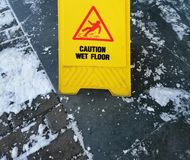 Caution ice - a sign for pedestrians in the winter stock photo