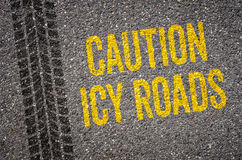 Caution icy roads. Lane with the text Caution icy roads Royalty Free Stock Photography